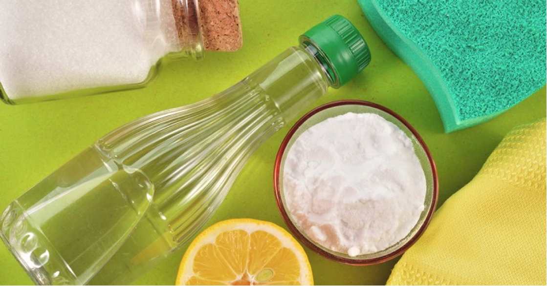 vinegar disinfectant bottle and natural cleaning supplies